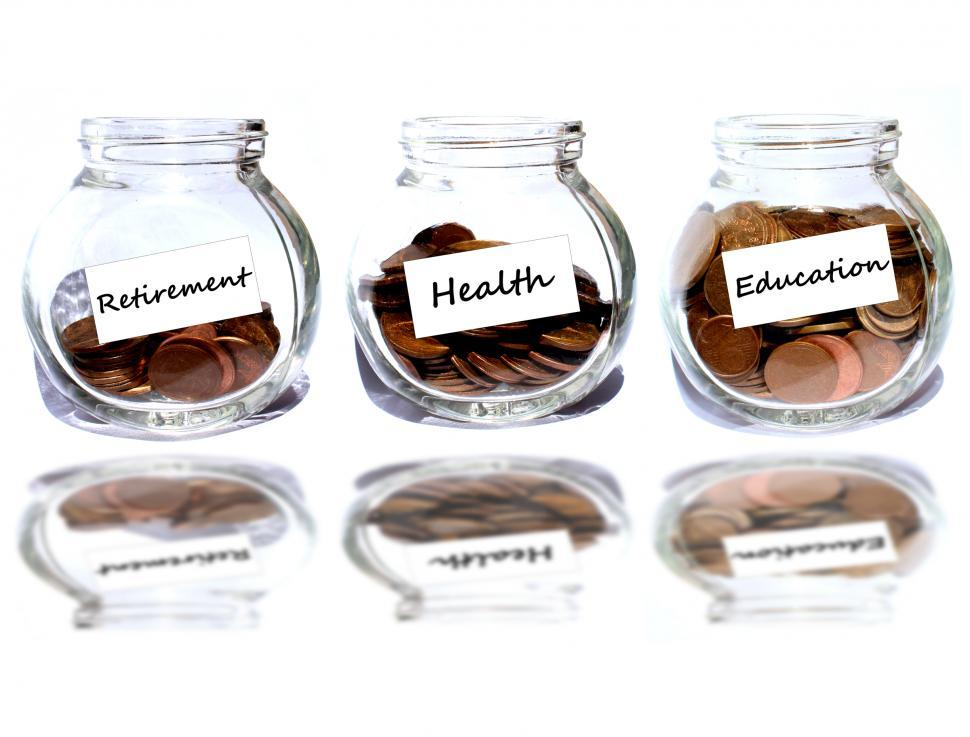 Download Free Stock Photo of Retirement and health and education Concept - Coins in the jar