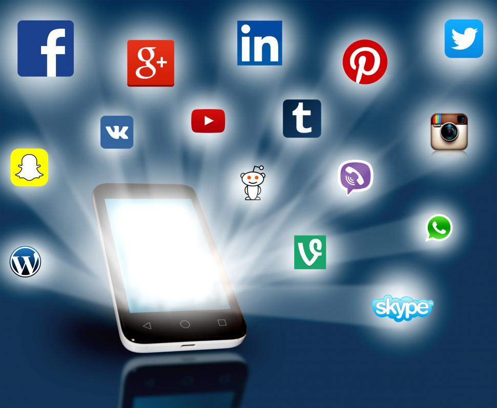 Download Free Stock Photo of Social media networks projecting out from smartphone. Editorial