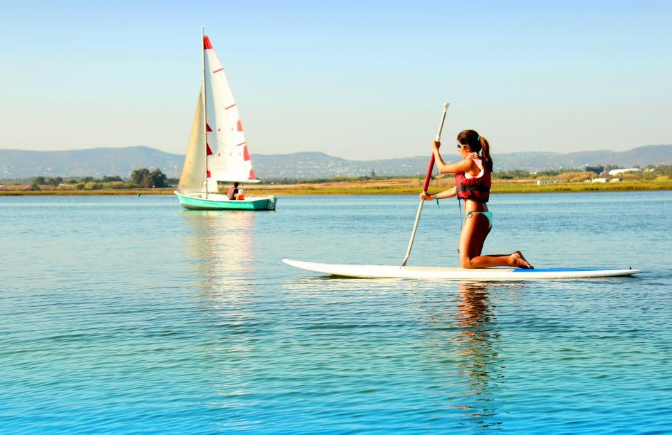 Download Free Stock Photo of Woman practicing stand-up paddle