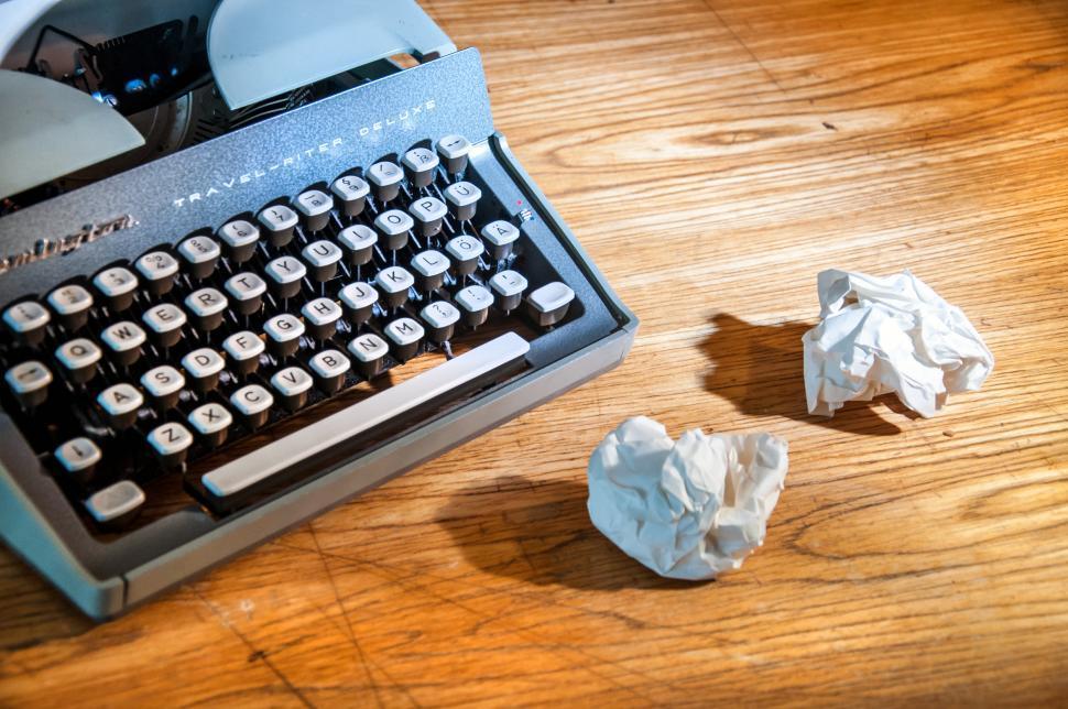 Download Free Stock Photo of writing Vintage typewriter and paper