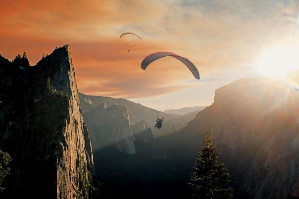 Download Free Stock Photo of Paragliding in the mountains at sunrise