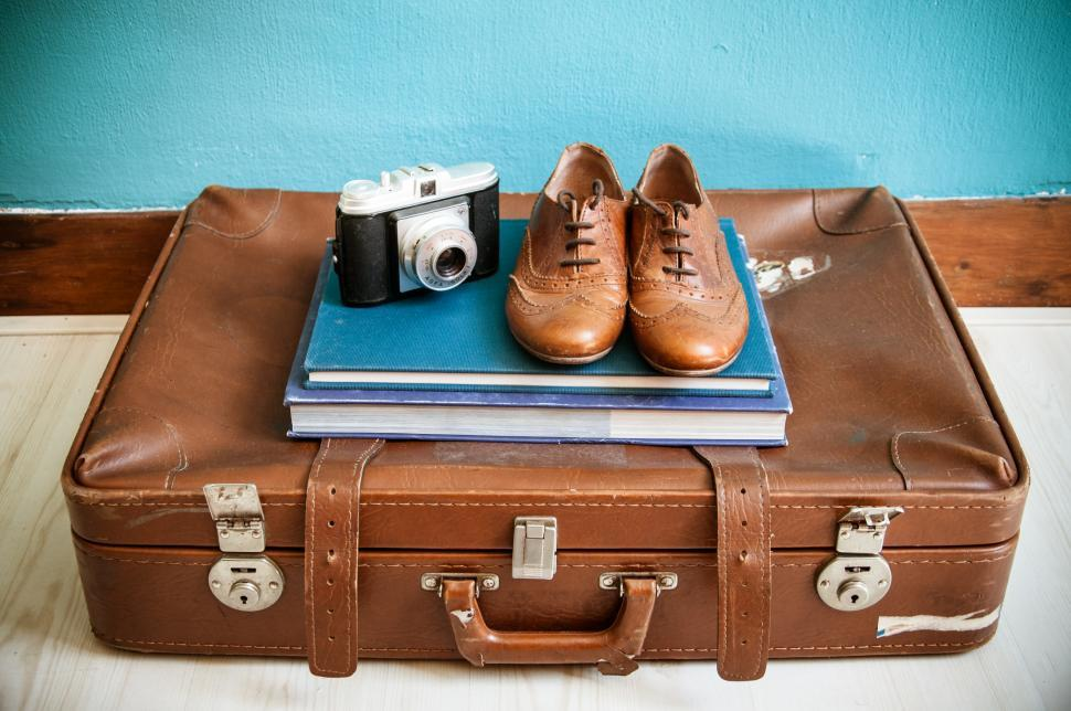 Download Free Stock HD Photo of vintage still life with suitcase and shoes Online