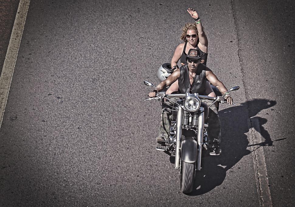 Download Free Stock HD Photo of Biker waving on a Harley Davidson - Grunge look Online