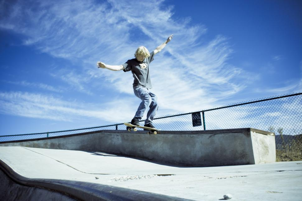 Download Free Stock Photo of Skateboarder Trick