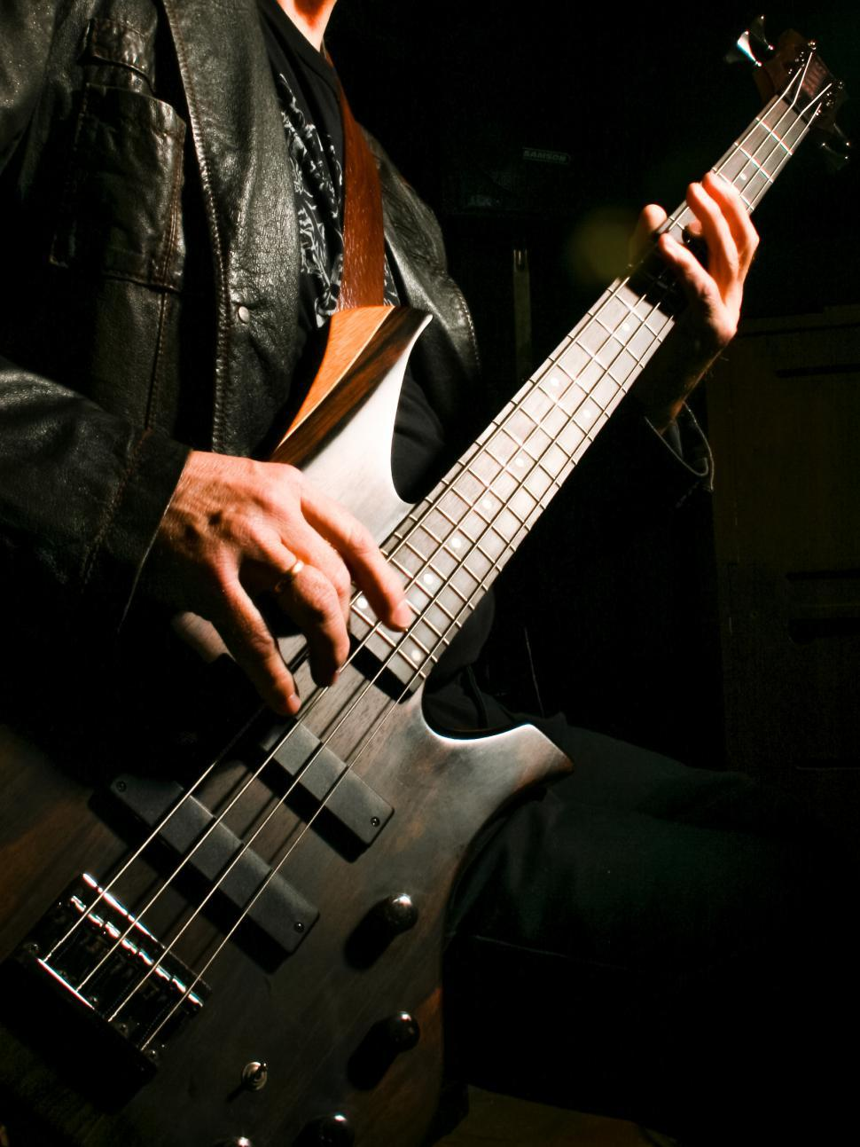 Download Free Stock HD Photo of man playing electric guitar Online