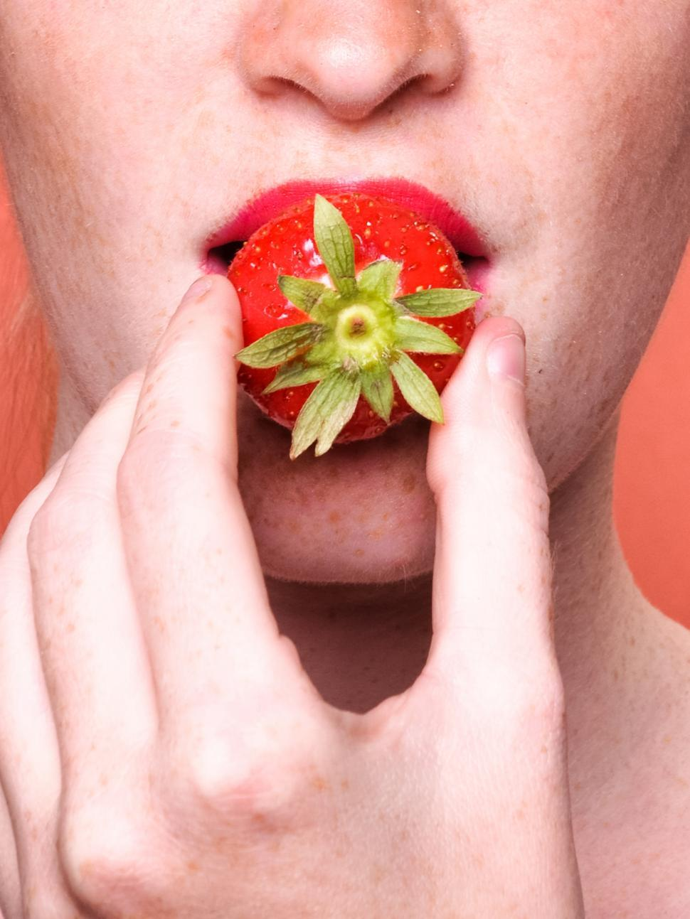 Download Free Stock HD Photo of close up of woman mouth eating strawberry Online