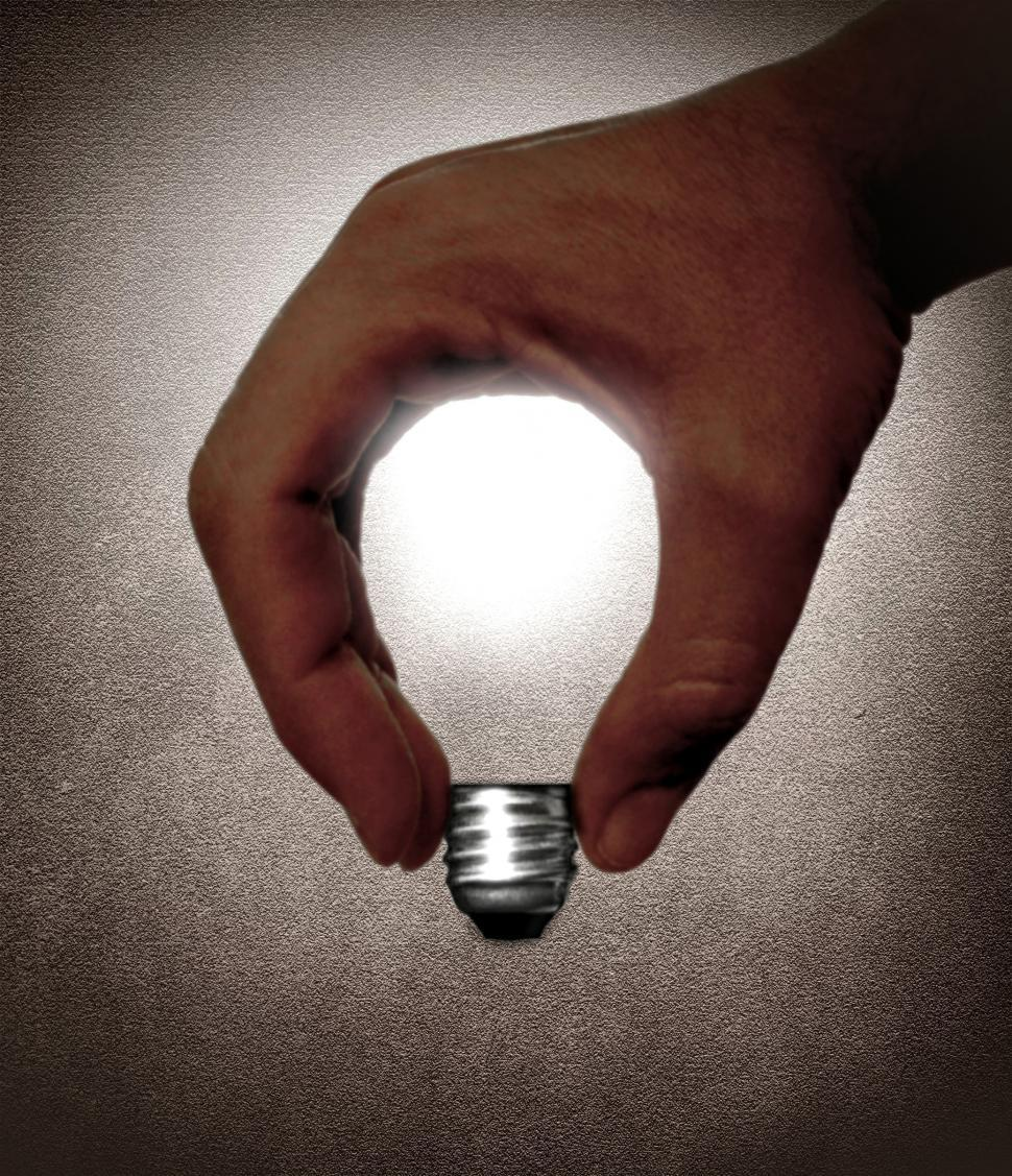 Download Free Stock Photo of Hand and lightbulb - Creativity and ideas concept