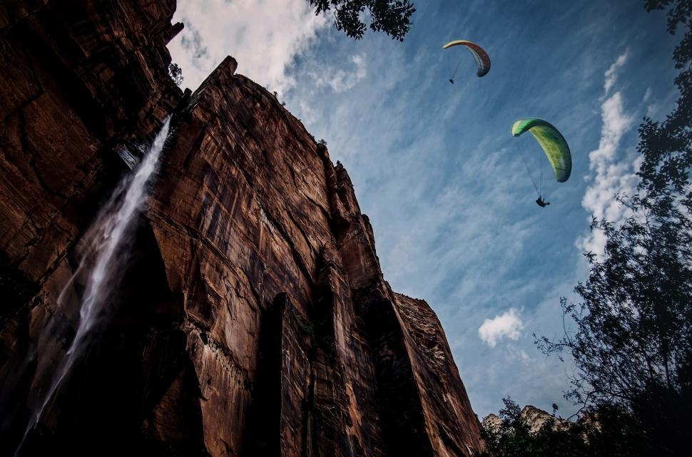 Download Free Stock HD Photo of Paragliding over a waterfall - Extreme sports illustration Online