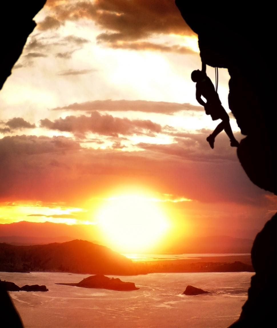 Download Free Stock HD Photo of Free-climber rising at sundown Online