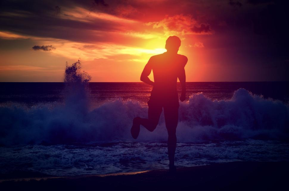 Download Free Stock Photo of Man running on the beach at sunset