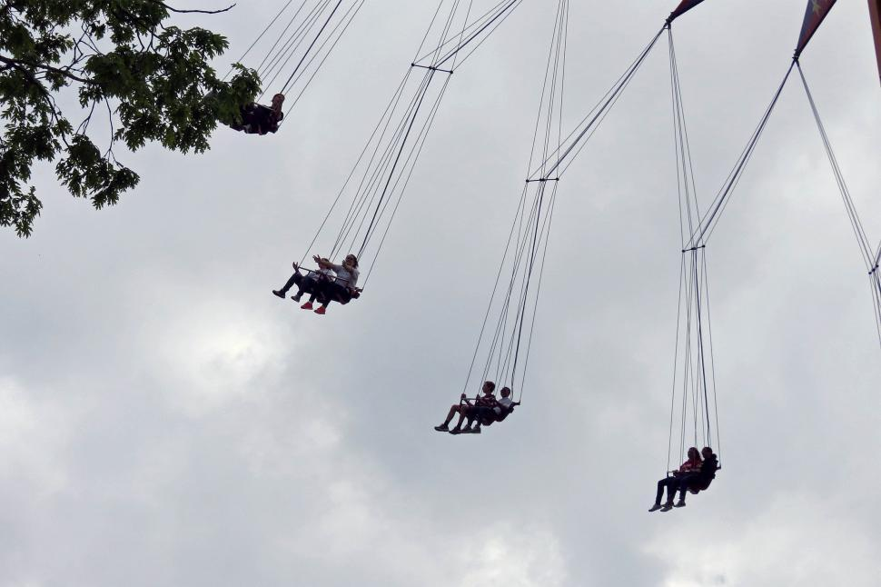 Download Free Stock Photo of People riding on swing ride at fair