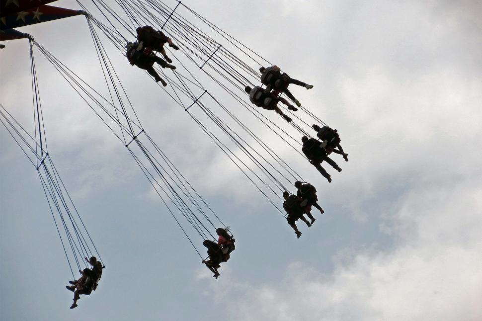 Download Free Stock Photo of People riding on swing ride