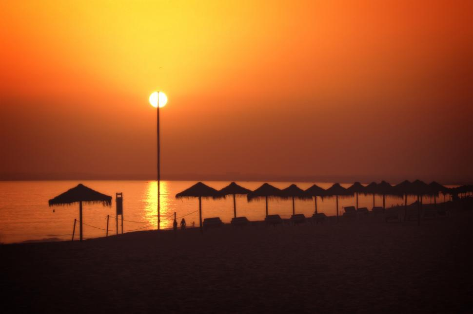 Download Free Stock Photo of Sun on a stick - A fiery sunset in Vale do Lobo beach, Algarve,