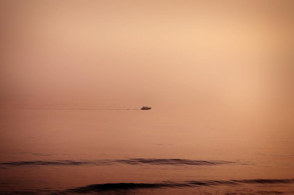 Download Free Stock HD Photo of Floating - A lonely distant boat cruising the horizon Online