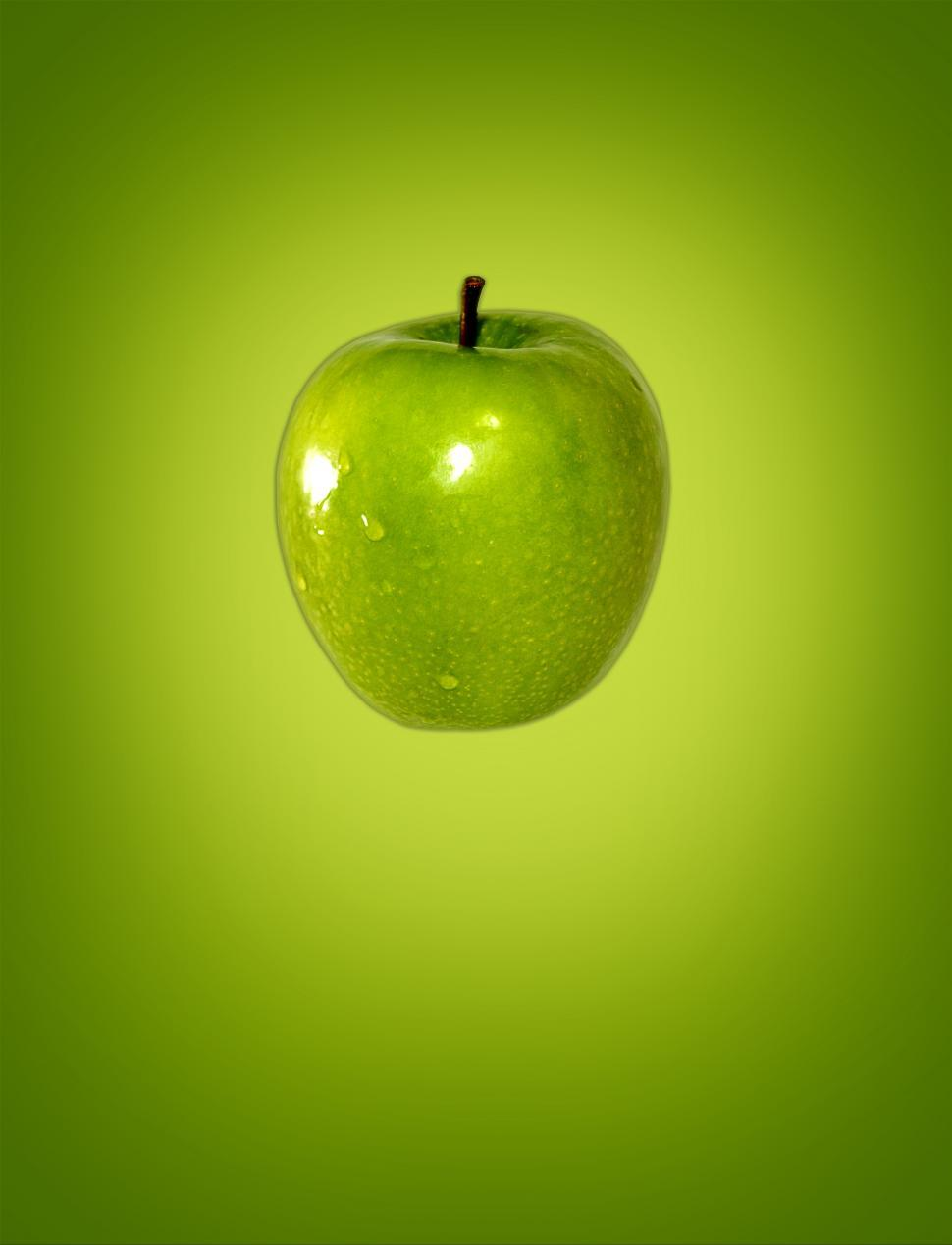 Download Free Stock Photo of Green apple on green background