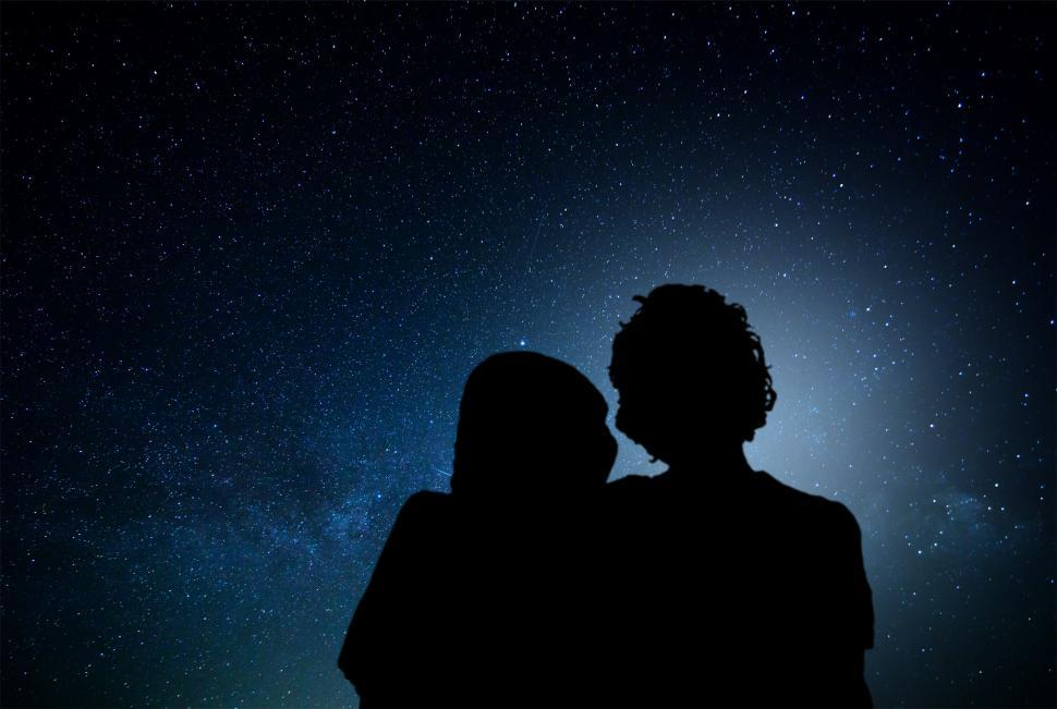 Download Free Stock HD Photo of Romantic couple watching the stars Online