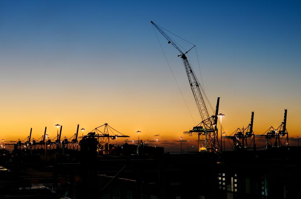 Download Free Stock HD Photo of Construction cranes at sunset Online