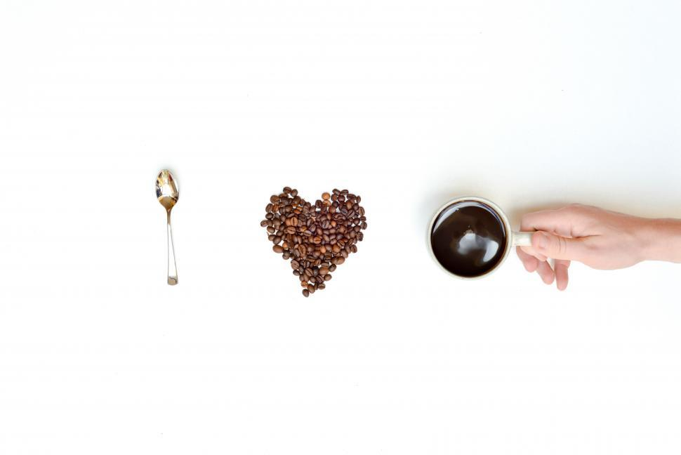 Download Free Stock HD Photo of Heart shape, coffee beans and a cup Online