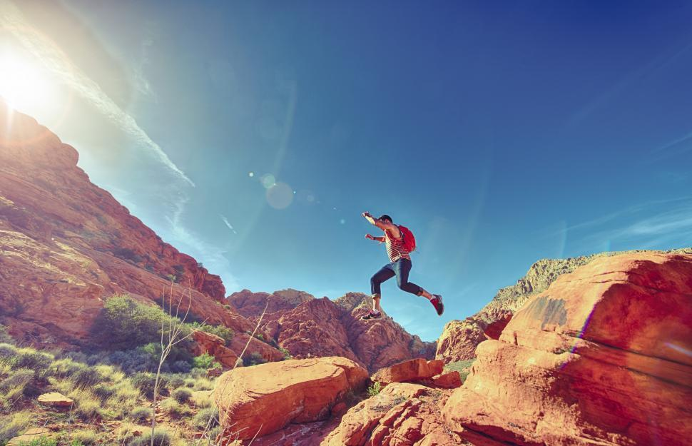 Download Free Stock HD Photo of Man jumping on rocks Online