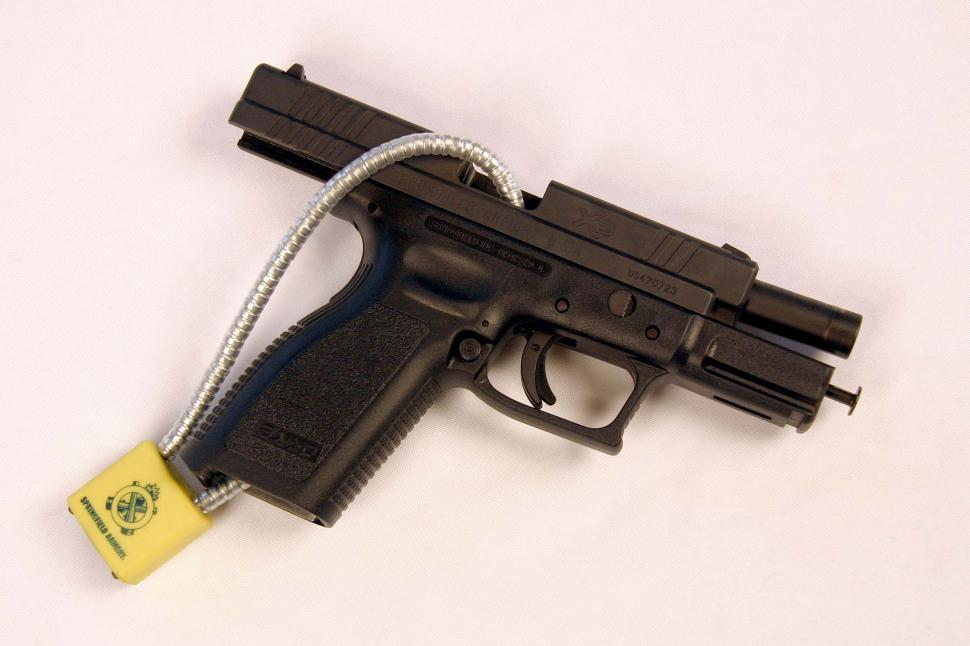 Download Free Stock Photo of 9mm Handgun with cable lock