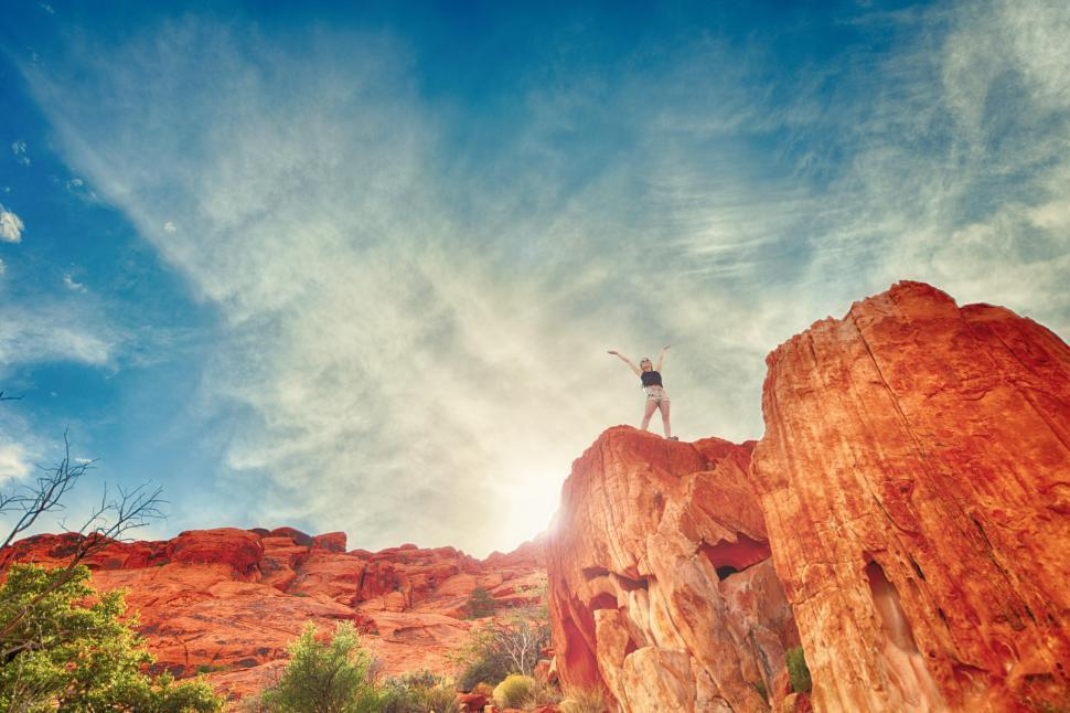 Download Free Stock Photo of Woman on top of cliff