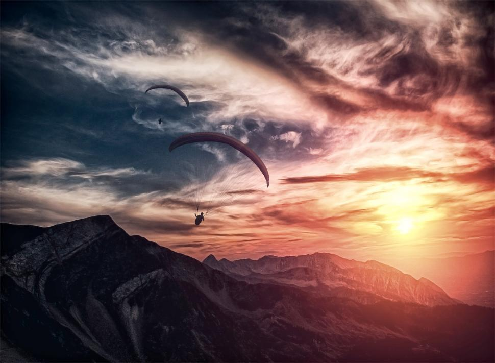 Download Free Stock Photo of Into the atmosphere - Paragliding over mountain ridge