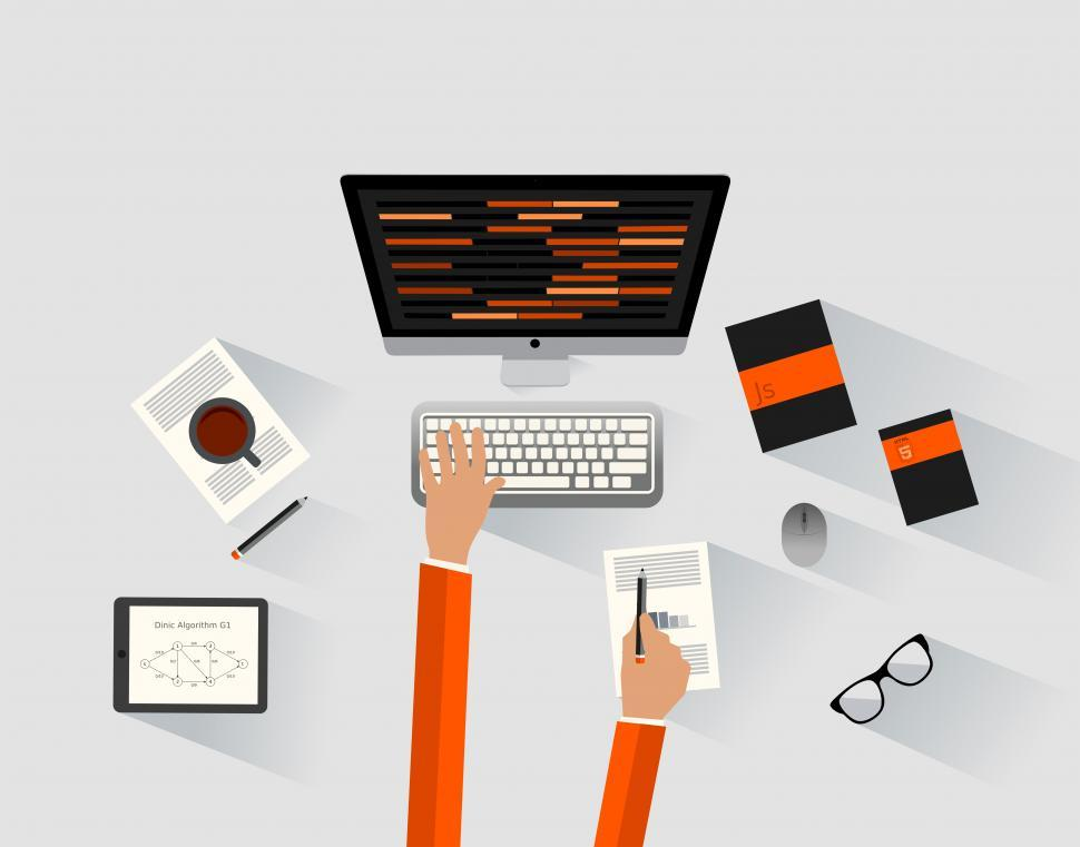 Download Free Stock Photo of A software engineer programming at the desk - Programmer and dev