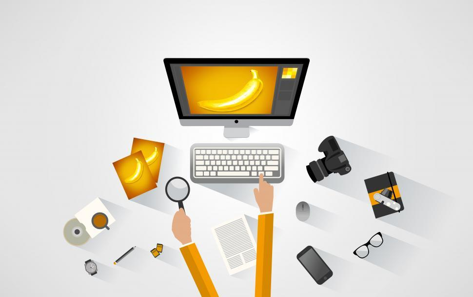 Download Free Stock Photo of Photographer working at the desk - Yellow tones