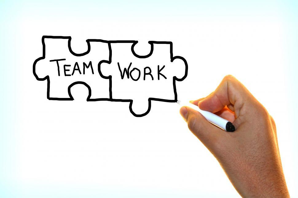 Download Free Stock HD Photo of Hand writing the words Team Work on virtual screen Online
