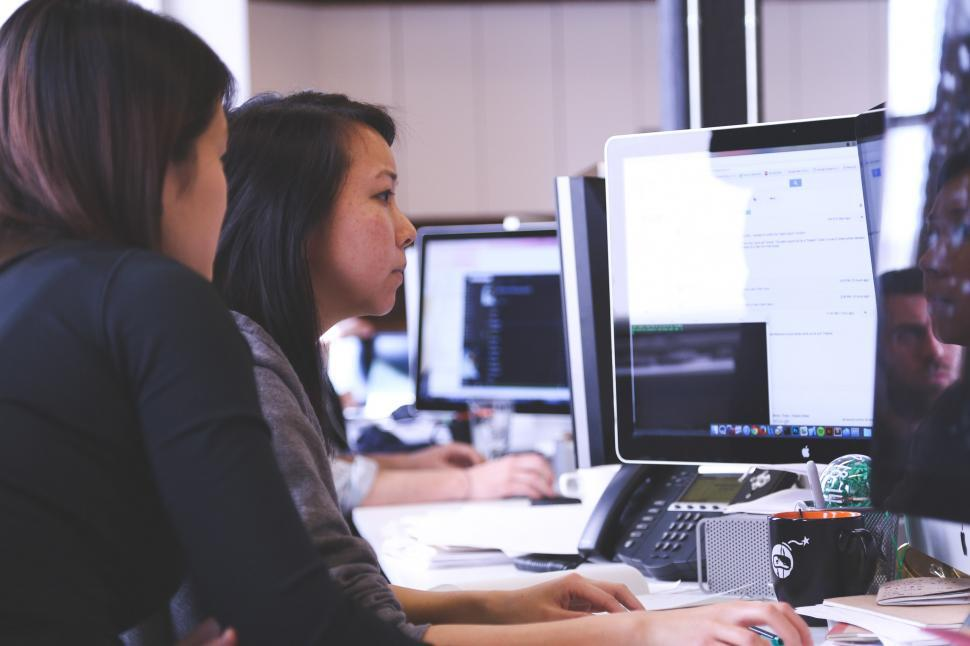 Download Free Stock HD Photo of Women work on computer Online
