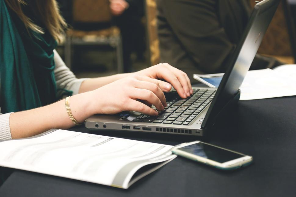 Download Free Stock HD Photo of Working on laptop Online