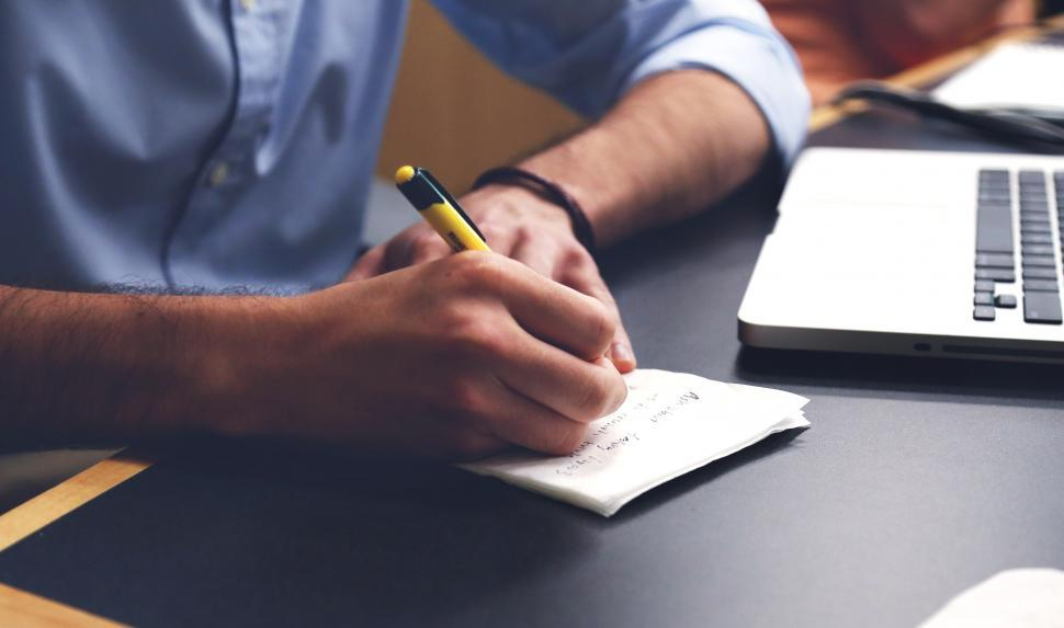 Download Free Stock Photo of Man taking notes on paper