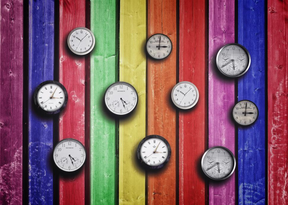Download Free Stock Photo of Clocks on colorful wood background - Time concept