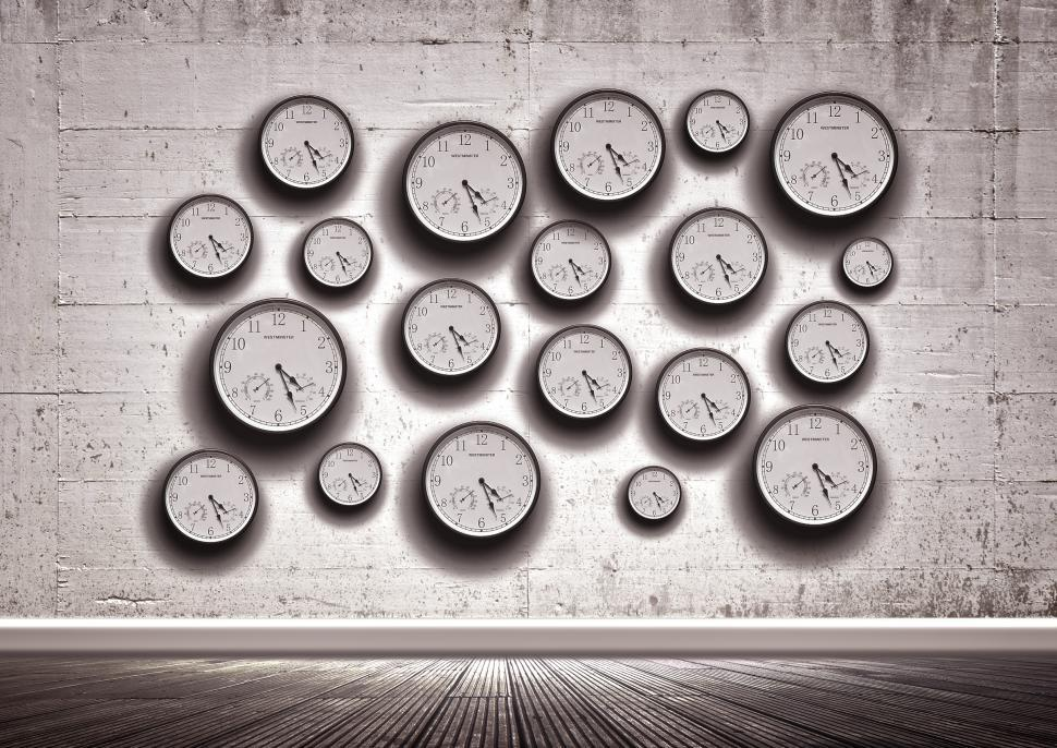 Download Free Stock HD Photo of Clocks in the wall - Time concept Online