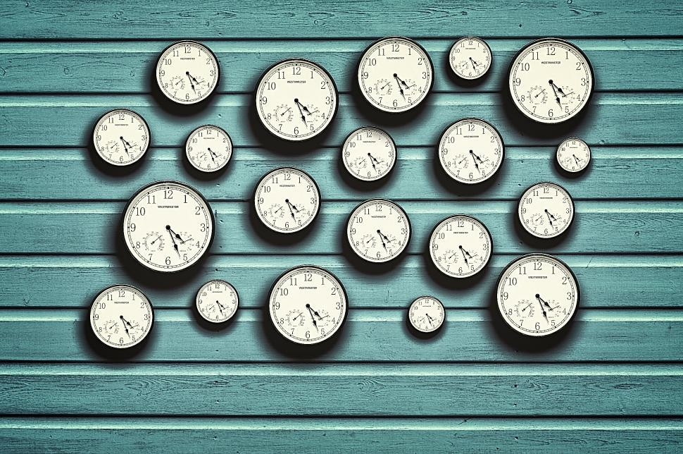 Download Free Stock Photo of Many clocks in a blue wooden background