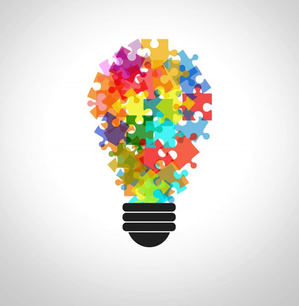 Download Free Stock Photo of Puzzle in a lightbulb - Problem solving concept