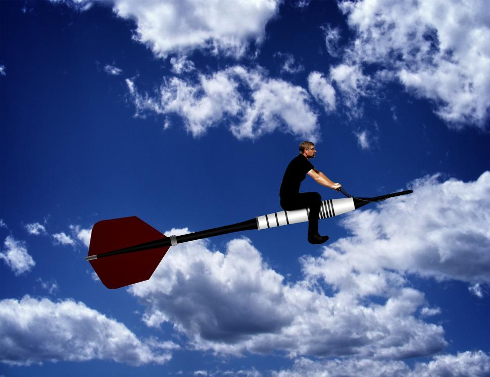 Download Free Stock HD Photo of Man riding a dart through the sky Online