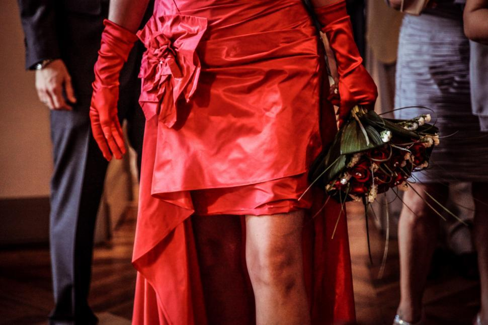 Download Free Stock Photo of A woman in red with flowers