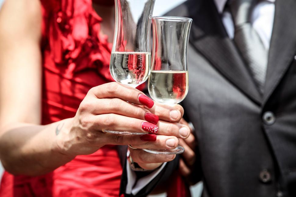 Download Free Stock Photo of Bride and groom holding champagne glasses