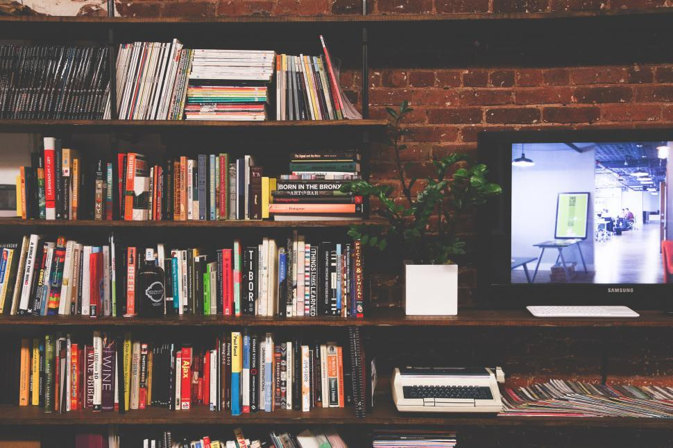 Download Free Stock Photo of Books on shelf with TV