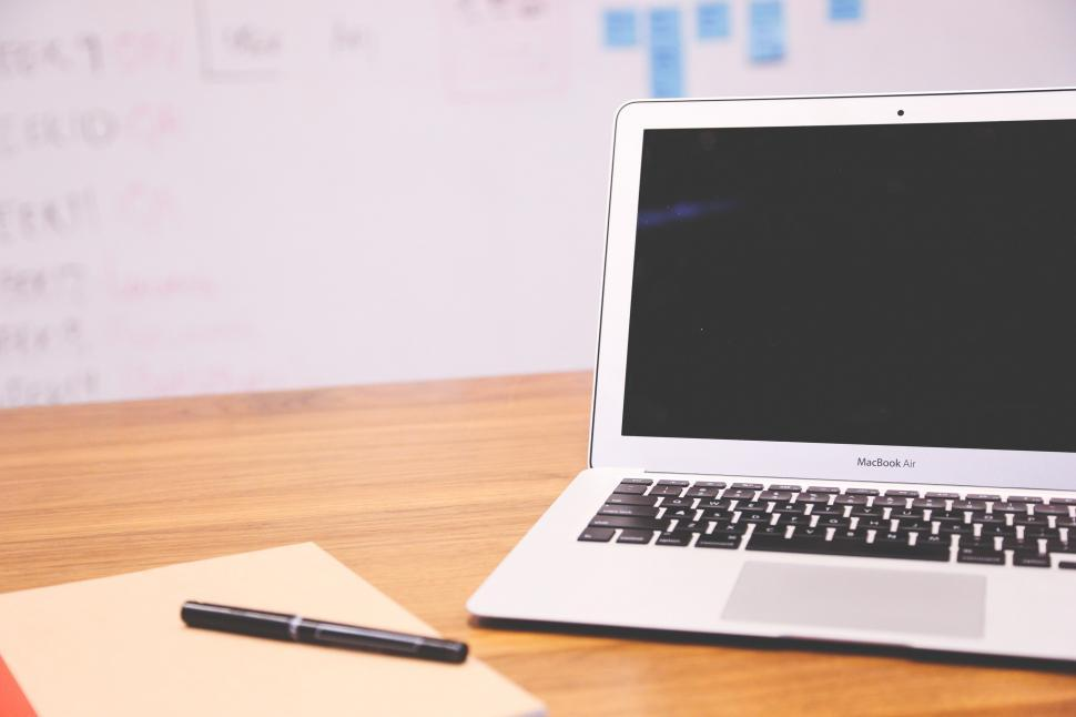 Download Free Stock Photo of Laptop open with notebook
