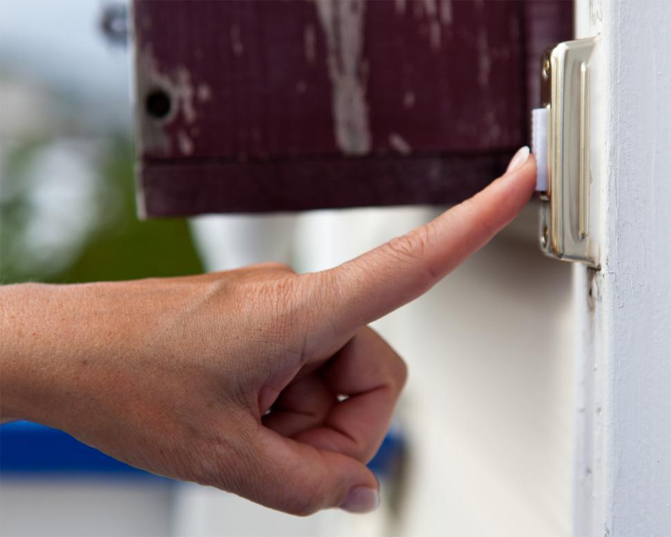 Download Free Stock HD Photo of Finger pressing a doorbell Online