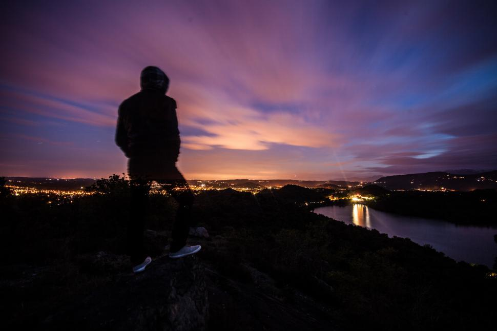 Download Free Stock Photo of Person standing and looking at the sunset
