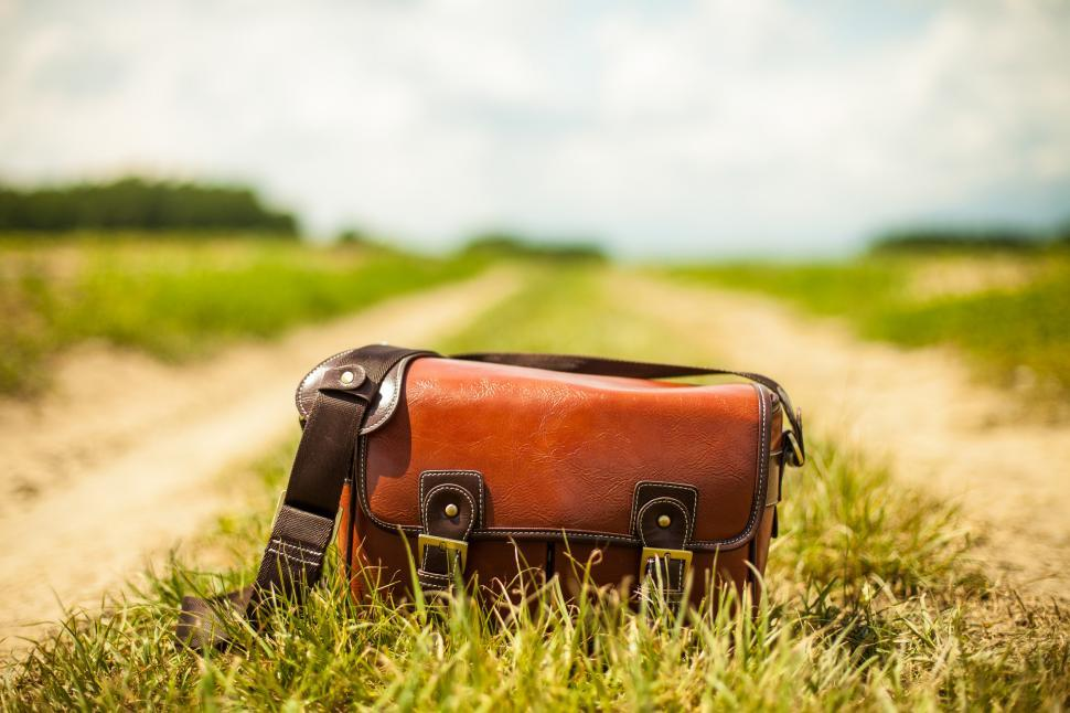 Download Free Stock HD Photo of Close view of shoulder bag on the ground Online