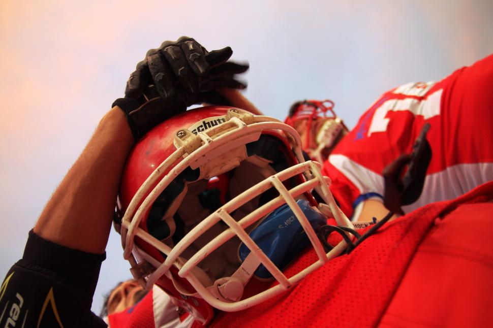Download Free Stock HD Photo of Player holding football helmet Online