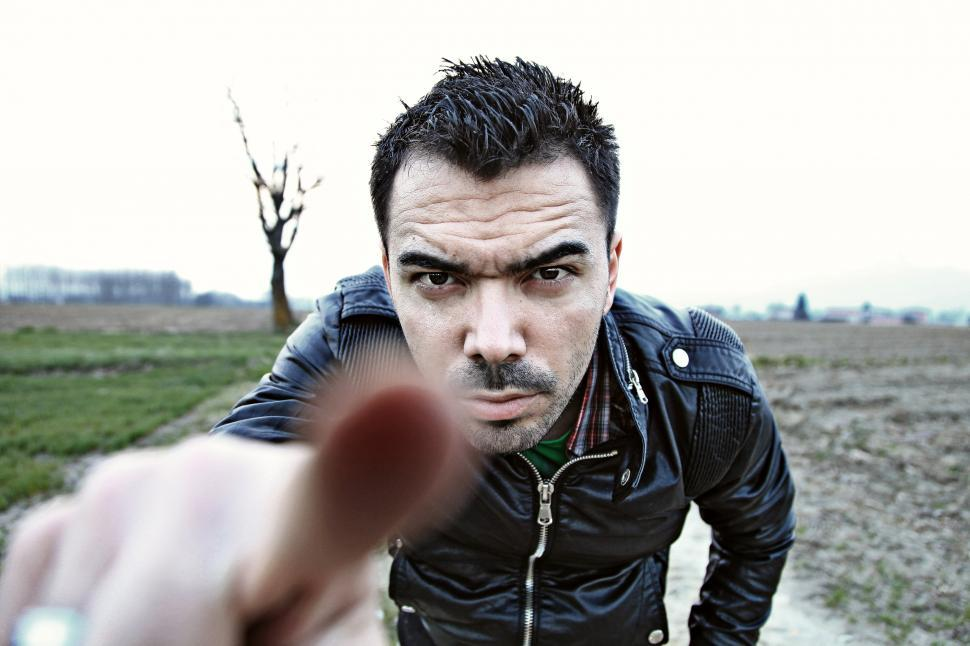 Download Free Stock Photo of Man looking at the camera, pointing his finger at the viewer