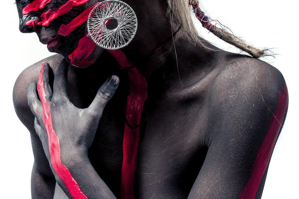 Download Free Stock Photo of Woman with black and red paint on her body