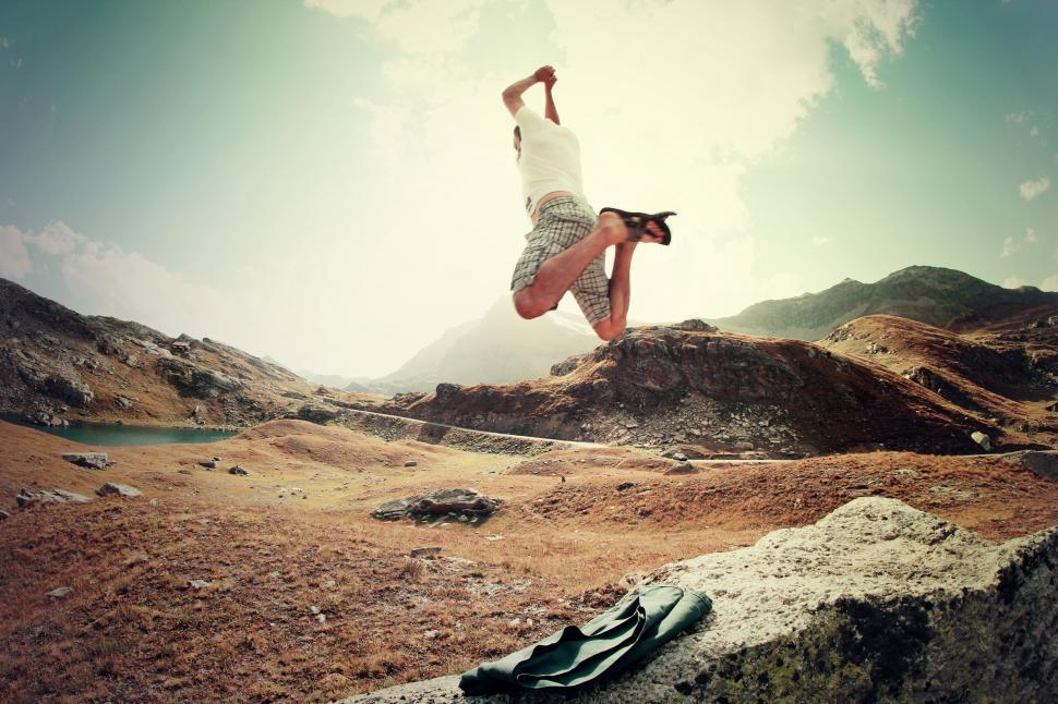 Download Free Stock Photo of Man jumping on rocks