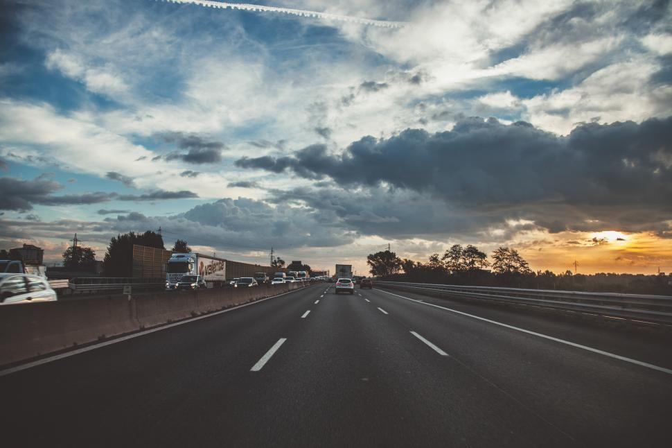 Download Free Stock HD Photo of White and grey clouds over highway Online