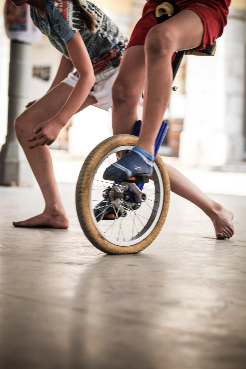 Download Free Stock Photo of Young boy riding a unicycle
